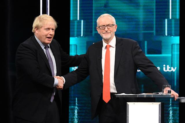 The two leaders shaking hands mid-way through the debate. (Getty)