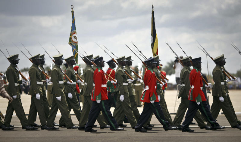 The Uganda People's Defence Force parade at a ceremony to celebrate the 50th anniversary of the country's independence from British rule, in Kampala, Uganda, Tuesday, Oct. 9, 2012. The East African country has come a long way from the days when brutal dictators were in charge, but it has not had a single peaceful transfer of power since 1962, and the potential for instability remains as opposition activists intensify their campaigns and authorities clamp down. (AP Photo/Rebecca Vassie)