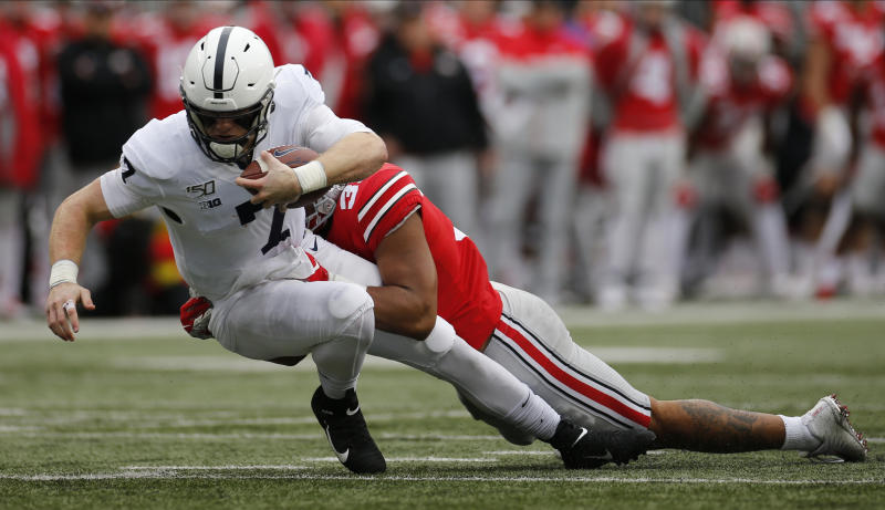 Ohio State linebacker Malik Harrison, right, tackles Penn State quarterback Will Levis during the second half of an NCAA college football game Saturday, Nov. 23, 2019, in Columbus, Ohio. Ohio State beat Penn State 28-17. (AP Photo/Jay LaPrete)
