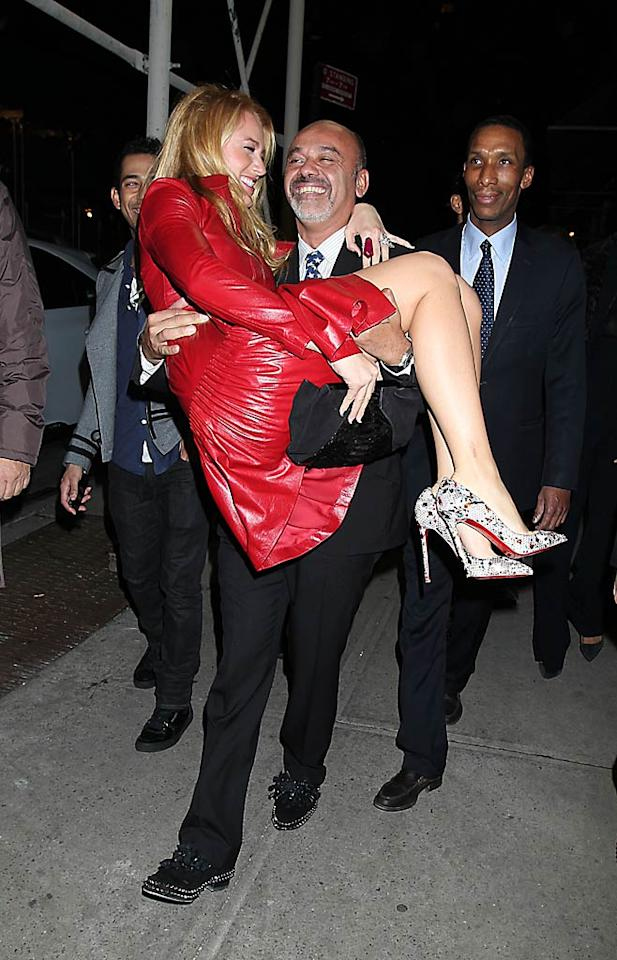 """Some women are lucky enough to afford a pair of Christian Louboutin shoes, but """"Gossip Girl"""" star Blake Lively got carried away by the designer himself outside his 20th Anniversary Party at Barney's in New York City on Tuesday. (11/1/2011)"""