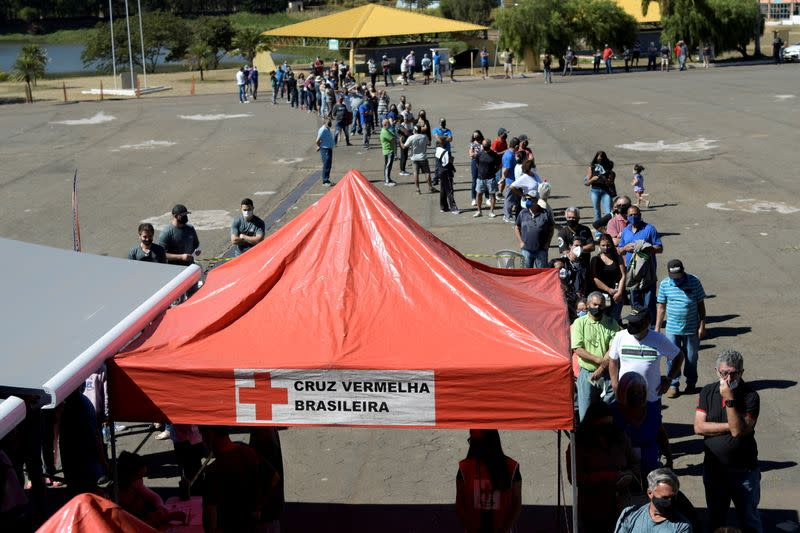 FILE PHOTO: A bus turned into a mobile vaccination center helps population during pandemic, in Ouro Branco