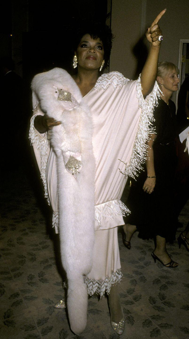 <p>Oprah upped the wow factor in a white dress with fringe trim she wore in 1986. </p>