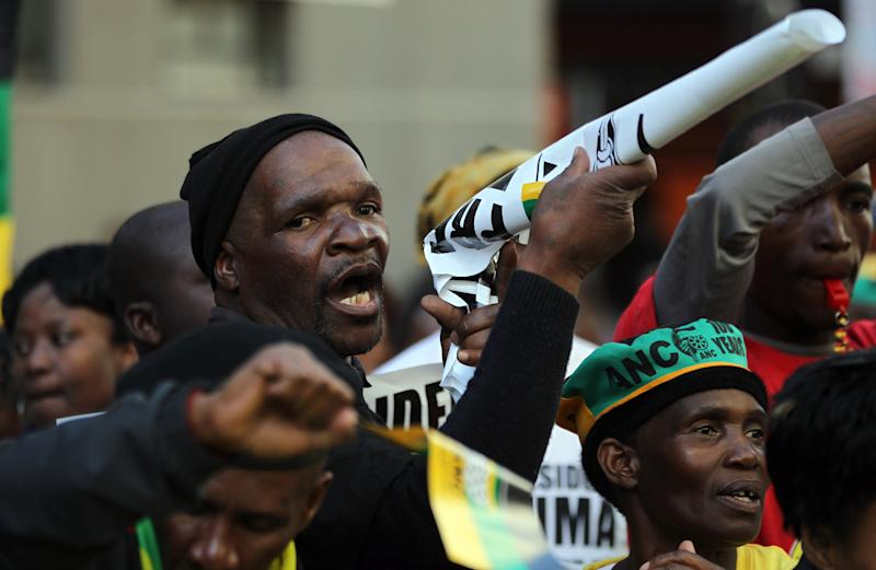 Ruling party African National Congress (ANC) supporters sing outside the South Gauteng High Court in Johannesburg, South Africa on Thursday May 24, 2012. President Jacob Zuma is asking the High Court to issue an order that display of the now-defaced painting violates his constitutional right to dignity. The gallery and the artist counter that freedom of expression, also protected by the constitution, is at stake. (AP Photo/Themba Hadebe)