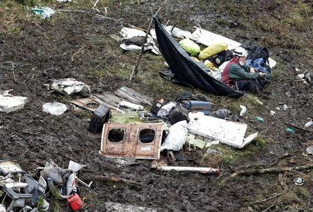 FILE PHOTO - A rescue worker sits near the wreckage of a plane that crashed into the Colombian jungle with Brazilian soccer team Chapecoense onboard near Medellin