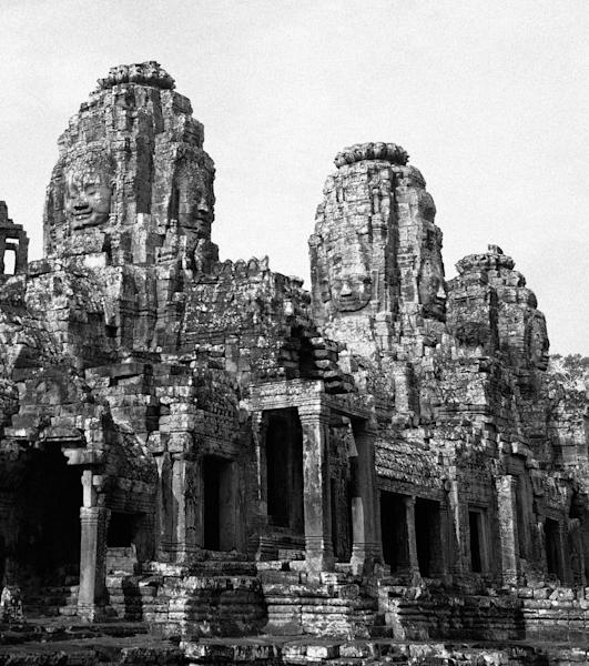 FILE - Faces of the Hindu god Brahman look out from towers at a temple in the Angkor Wat complex in Siem Reap, Cambodia on June 16, 1950. In the Hindu cycle of the universe, Brahman created Brahma, whose day lasts 4,320,000,000 human years. In the course of the day, Brahma creates the universe and destroys it, using fire and water. The next day, and every day for his 100-year lifespan, he does it again. Meanwhile, an infinite number of Brahmas are creating an infinite number of universes. (AP Photo/James Mills)