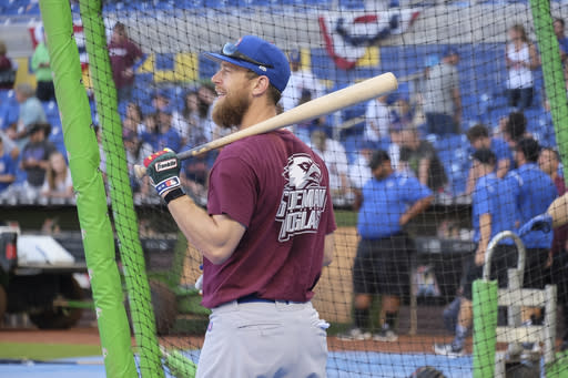 Chicago Cubs' Ben Zorbist takes batting practice prior to a baseball game against the Miami Marlins in Miami, Friday, March 30, 2018. (AP Photo/Gaston De Cardenas)