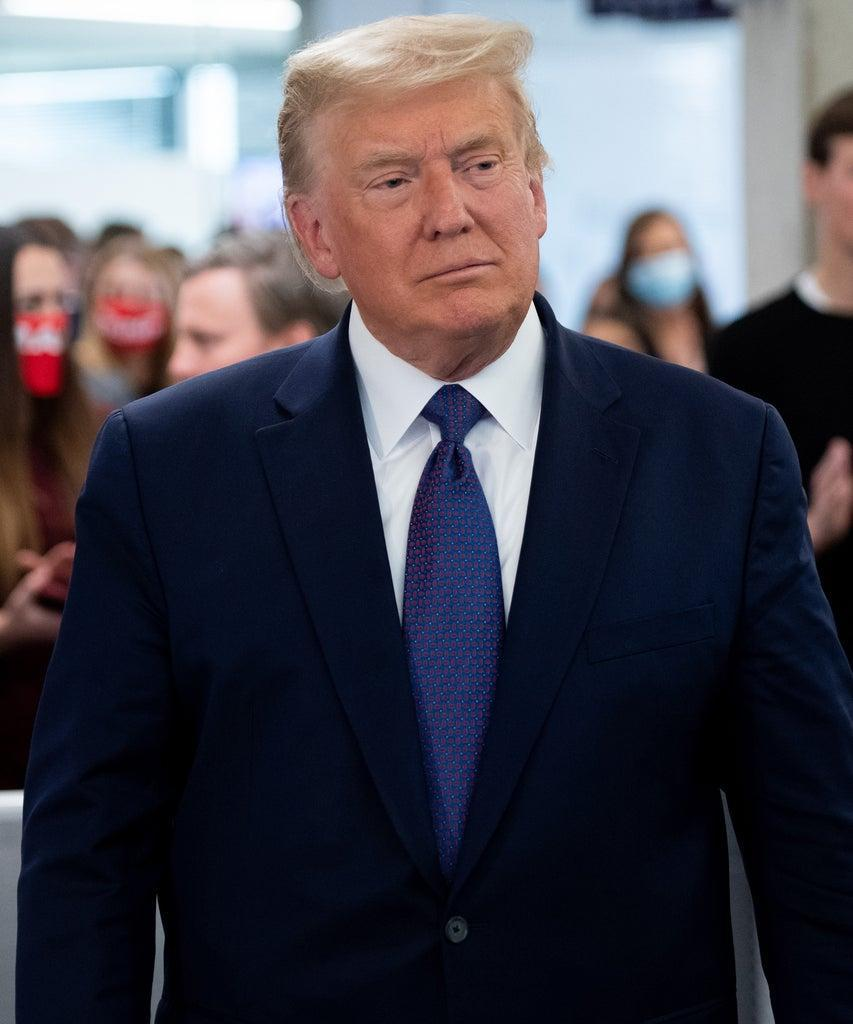 US President Donald Trump visits his campaign headquarters in Arlington, Virginia, November 3, 2020. – A bitterly divided America was going to the polls on Tuesday amid the worst pandemic in a century and an economic crisis to decide whether to give President Donald Trump four more years or send Democrat Joe Biden to the White House. A record-breaking number of early votes — more than 100 million — have already been cast in an election that has the nation on edge and is being closely watched in capitals around the world. (Photo by SAUL LOEB / AFP) (Photo by SAUL LOEB/AFP via Getty Images)