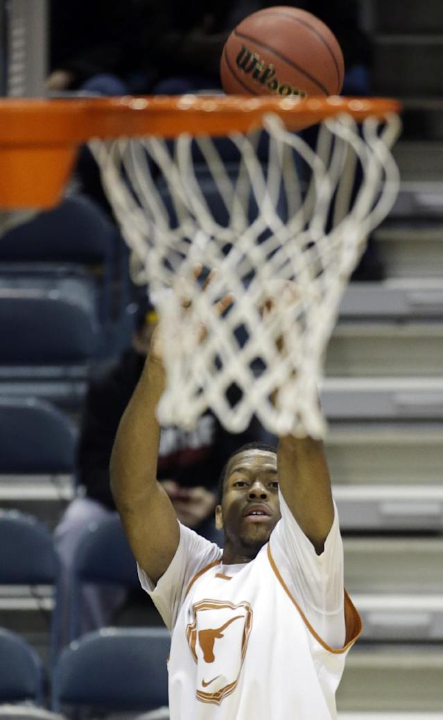 Texas guard Martez Walker shoots during a practice session for their NCAA college basketball tournament game Wednesday, March 19, 2014, in Milwaukee. Texas plays Arizona State on Thursday. (AP Photo/Morry Gash)
