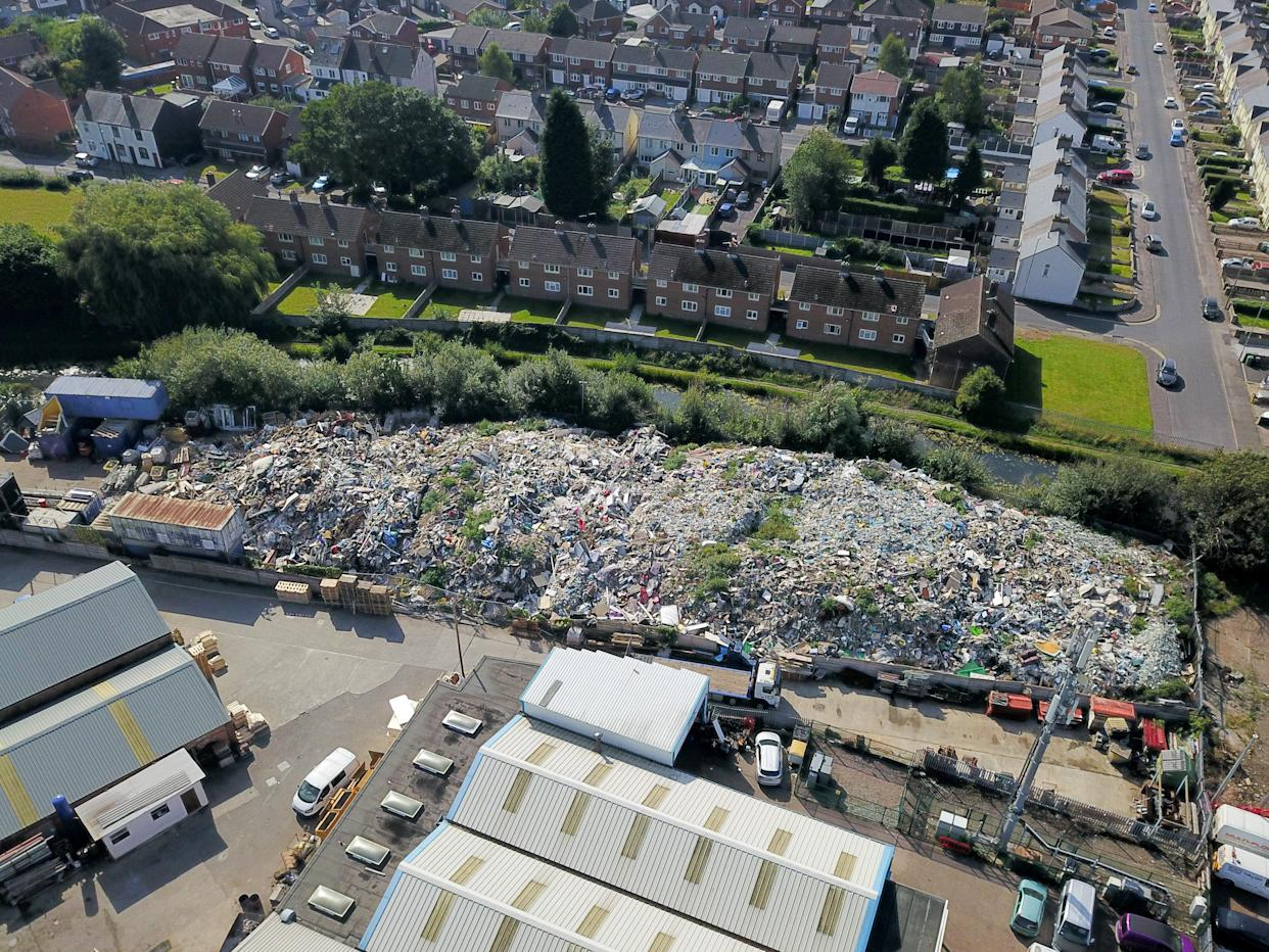 Aerial view of a mountain of rubbish in Willenhall, West Midlands. (SWNS)