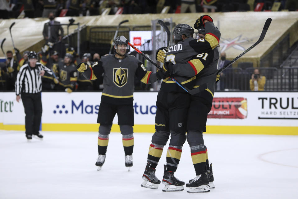 Vegas Golden Knights defenseman Zach Whitecloud (2) celebrates with right wing Mark Stone (61) after Whitecloud scored a goal against the Minnesota Wild during the second period of Game 7 of an NHL hockey Stanley Cup first-round playoff series Friday, May 28, 2021, in Las Vegas. (AP Photo/Joe Buglewicz)