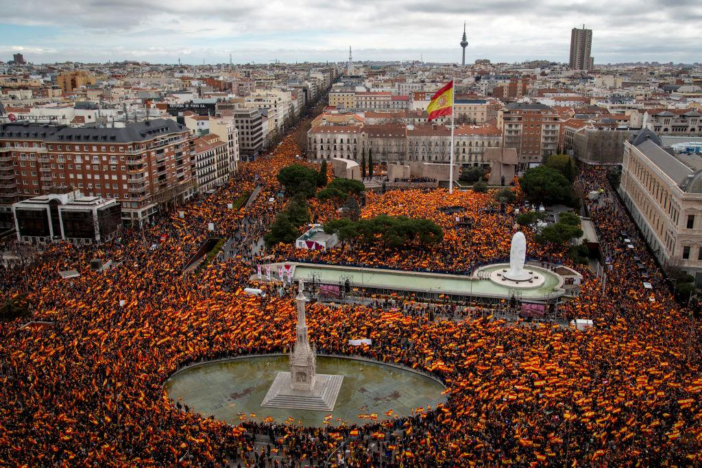 <p>Protesters wave Spanish flags during a right-wing demonstration against Prime Minister Pedro Sanchez in Colon Square on Feb. 10, 2019 in Madrid, Spain. The opposition called for a demonstration against Sanchez after his government proposed having an observer on talks with Catalonia separatists. Tens of thousands of supporters of right wing 'Partido Popular' (People's Party), 'Ciudadanos' (Citizens) and far-right 'VOX' attended the protest under the slogan 'For a united Spain. Elections now!' (Photo from Pablo Blazquez Dominguez/Getty Images) </p>