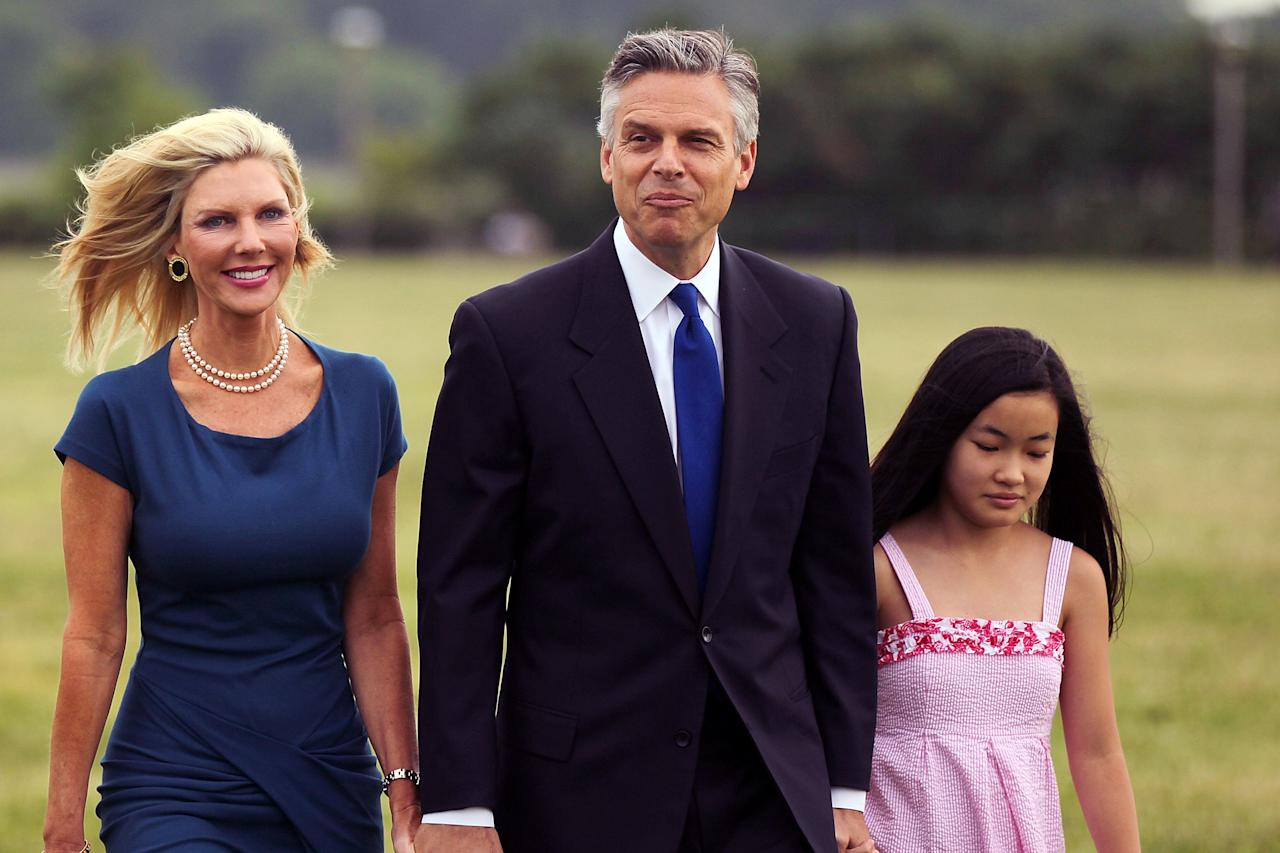 JERSEY CITY, NJ - JUNE 21:  Republican Jon Huntsman walks with his wife Mary Kaye and daughter on his way to a press conference to announce his bid for the presidency at Liberty State Park June 21, 2011 in Jersey City, New Jersey. Huntsman, until recently the U.S. ambassador to China under President Obama, emphasized his record as a two-term governor of Utah.  (Photo by Spencer Platt/Getty Images)