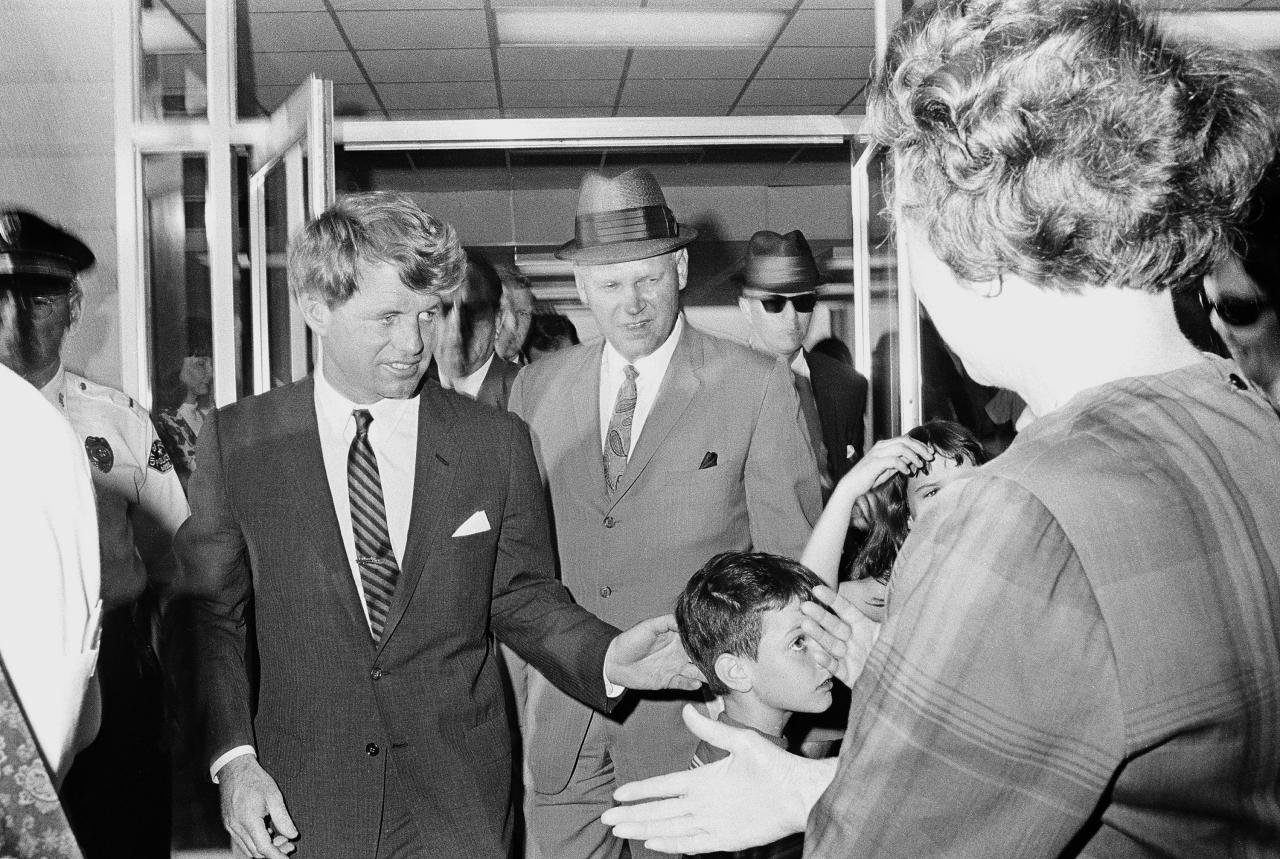 <p>Sen. Robert F. Kennedy arrives at the Jackson, Miss., airport, for an antipoverty hearing, April 10, 1967. (Photo: Jack Thornell/AP) </p>