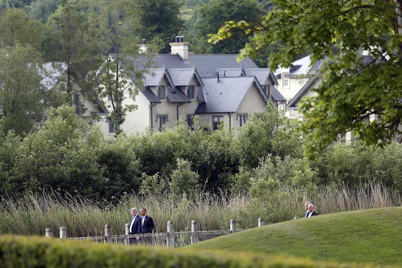 US President Barack Obama and Canadian Prime Minister Stephen Harper, left, walk to a group photo opportunity during the G-8 summit at the Lough Erne golf resort in Enniskillen, Northern Ireland, on Tuesday, June 18, 2013. The final day of the G-8 summit of wealthy nations is ending with discussions on globe-trotting corporate tax dodgers, a lunch with leaders from Africa, and suspense over whether Russia and Western leaders can avoid diplomatic fireworks over their deadlock on Syria's civil war. (AP Photo/Lefteris Pitarakis)