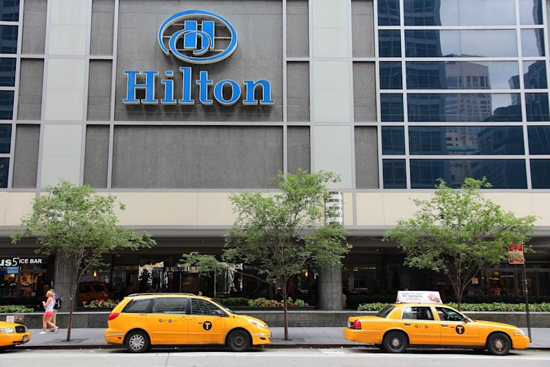 New York, United States - July 4, 2013: People walk past Hilton hotel at 6th Avenue in New York. Hilton is the 38th largest private company in the United States according to Forbes.