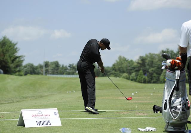 Tiger Woods takes a swing at the driving range during practice round for the Quicken Loans National golf tournament, Tuesday, June 24, 2014, in Bethesda, Md. (AP Photo/Nick Wass)