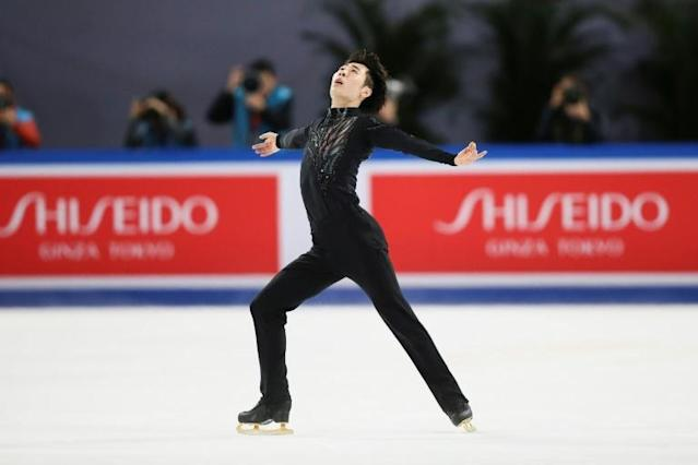 Jin Boyang of China -- sproting gold-coloured blades -- won the Men's title at the ISU Grand Prix Cup of China figure skating event (AFP Photo/STR)