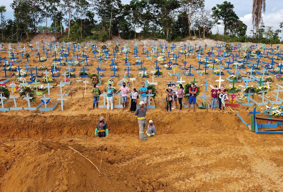 "<span class=""caption"">A burial takes place at a cemetery in Manaus, Brazil. The grave area hosts suspected and confirmed victims of the pandemic.</span> <span class=""attribution""><a class=""link rapid-noclick-resp"" href=""https://www.gettyimages.com/detail/news-photo/aerial-picture-showing-a-burial-taking-place-at-an-area-news-photo/1210677694?adppopup=true"" rel=""nofollow noopener"" target=""_blank"" data-ylk=""slk:Getty Images / Michael Dantas"">Getty Images / Michael Dantas</a></span>"
