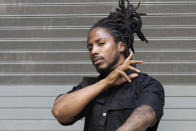 """Rapper D Smoke poses for a portrait in Los Angeles on Saturday, Dec. 26, 2020. The rapper and school teacher is nominated for two Grammy Awards, one for best rap album for """"Black Habits,"""" and one for best new artist. The 63rd Annual Grammy Awards will be held on Sunday, March 14. (Willy Sanjuan/Invision/AP)"""
