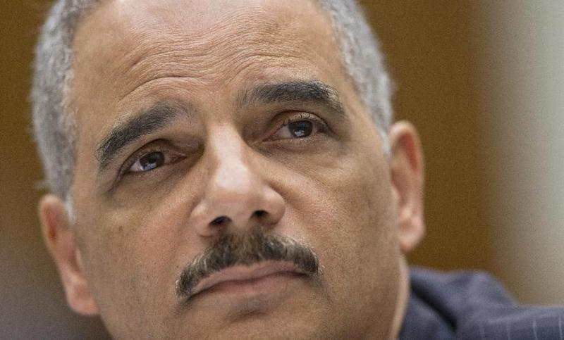 FILE - In this May 15, 2013 file photo, Attorney General Eric Holder, the nation's top law enforcement official, testifies on Capitol Hill in Washington.  (AP Photo/J. Scott Applewhite, File)