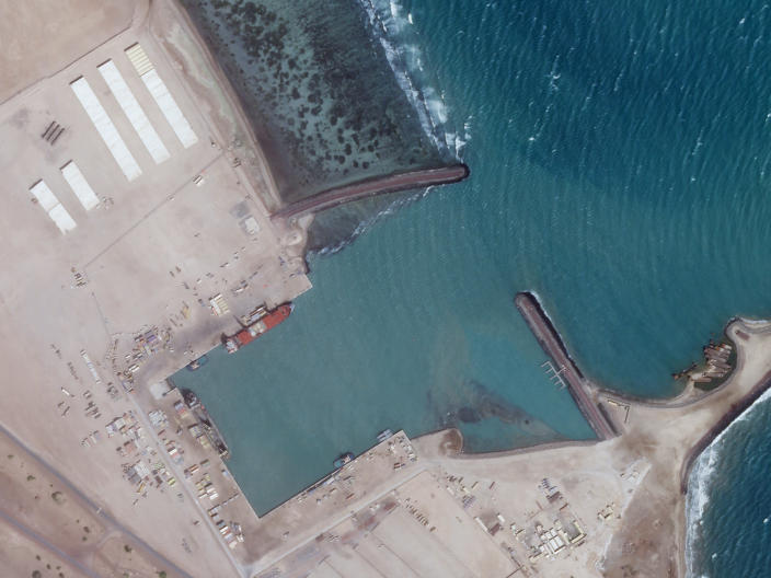 A Feb. 5, 2021, satellite photo from Planet Labs Inc. shows an empty port at an Emirati military base in Assab, Eritrea. The United Arab Emirates is dismantling parts of a military base it runs in the East African nation of Eritrea after it pulled back from the grinding war in nearby Yemen, satellite photos analyzed by The Associated Press show. (Planet Labs Inc. via AP)