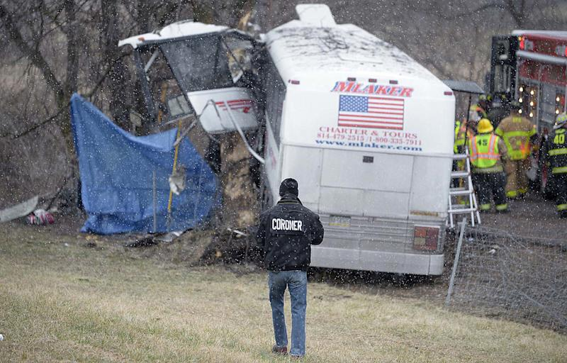 Members of the Cumberland County Coroners Office investigate the scene of a tour bus crash on the Pennsylvania Turnpike on Saturday, March 16, 2013 near Carlisle, Pa. Authorities say the tour bus crashed on the freeway at mile marker 227 in central Pennsylvania, and serious injuries have been reported. Megan Silverstram of the Cumberland County public safety department says the crash in the eastbound lanes of the Pennsylvania Turnpike was reported just before 9 a.m. Saturday. She says there are reports of multiple injuries, including that some are serious. (AP Photo/The Sentinel, Jason Malmont ) MANDATORY CREDIT