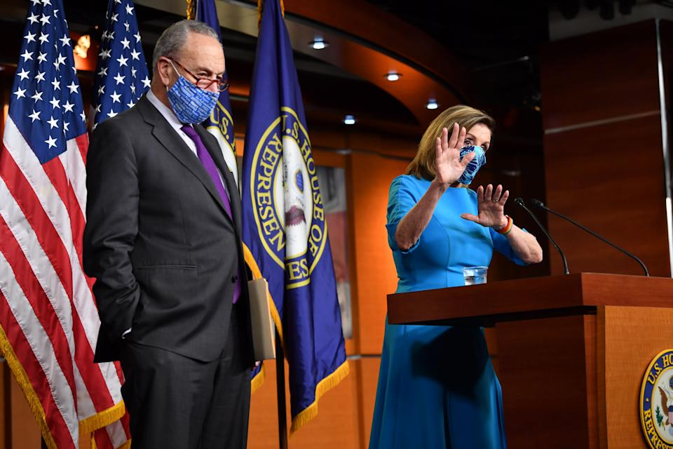 US Speaker of the House, Nancy Pelosi (R), Democrat of California, and Senate Minority Leader Chuck Schumer, Democrat of New York hold a press briefing on Capitol Hill in Washington, DC, on November 6, 2020. (Photo by Nicholas Kamm / AFP) (Photo by NICHOLAS KAMM/AFP via Getty Images)