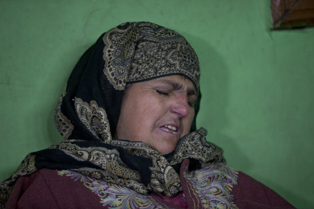 In this Dec. 26, 2018, photo, Fareeda Rasheed, mother of a Kashmiri boy Mudassir Rashid Parray grieves inside her house in Hajin village, north of Srinagar, Indian controlled Kashmir. Mudassir, who was then 14-years-old, and another teenager walked away from a local soccer pitch in the Kashmiri town of Hajin on a hot day in August, only to return home months later in body bags. Dying with his teammate in an 18-hour firefight in December, Mudassir became the youngest militant slain fighting Indian troops in a three-decade insurgency in Kashmir. (AP Photo/Dar Yasin)