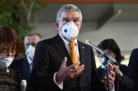 International Olympic Committee (IOC) president Thomas Bach wearing a face mask speaks to the media after his meeting with Japan's Prime Minister Yoshihide Suga in Tokyo