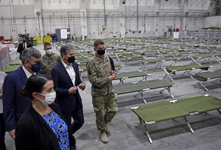 US Secretary of State Antony Blinken, centre, tours a processing centre for Afghan evacuees, at al-Udeid Air Base, in Doha, Qatar, Tuesday, Sept. 7, 2021. (Olivier Douliery/Pool Photo via AP)