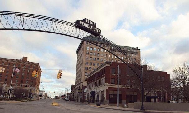 PHOTO: A Flint 'Vehicle City' sign stands on Saginaw Street in downtown Flint, Mich. (Janet Weinstein/ABC News)
