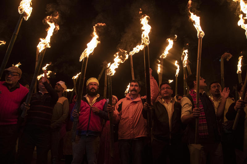 Indians participate in a torch light procession to protest against the Citizenship Amendment Bill (CAB) in Gauhati, India, Monday, Dec. 9, 2019. The bill that seeks to grant Indian citizenship to non-Muslim refugees from Pakistan, Bangladesh and Afghanistan is being debated in the Indian Parliament Monday. (AP Photo/Anupam Nath)