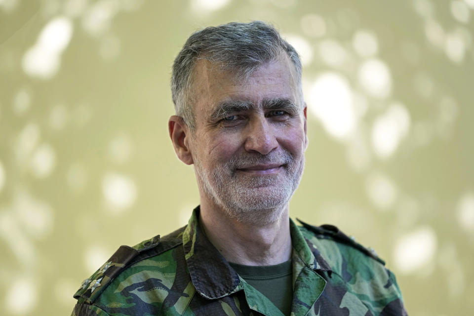 Rear Admiral Henrique Gouveia e Melo poses for a portrait outside a vaccination center in Lisbon, Tuesday, Sept. 21, 2021. As Portugal nears its goal of fully vaccinating 85% of the population against COVID-19 in nine months, other countries want to know how it was able to accomplish the feat. A lot of the credit is going to Gouveia e Melo. (AP Photo/Armando Franca)