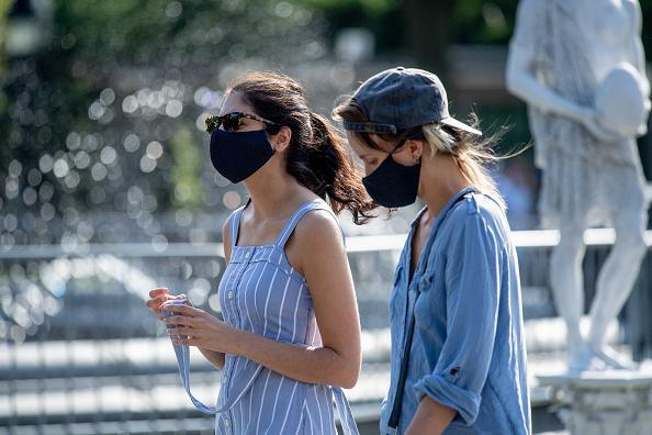 Park visitors wear masks in Washington Square Park during the third phase of the coronavirus reopening in New York.