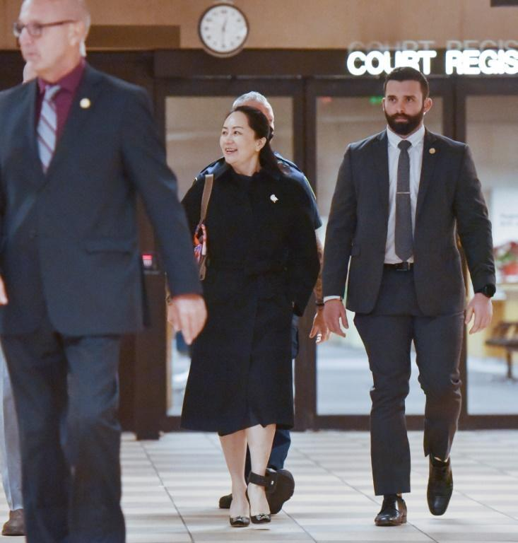 Huawei chief financial officer Meng Wanzhou leaves British Columbia Supreme Court with her security detail after the second day of her extradition hearing (AFP Photo/Don MacKinnon)