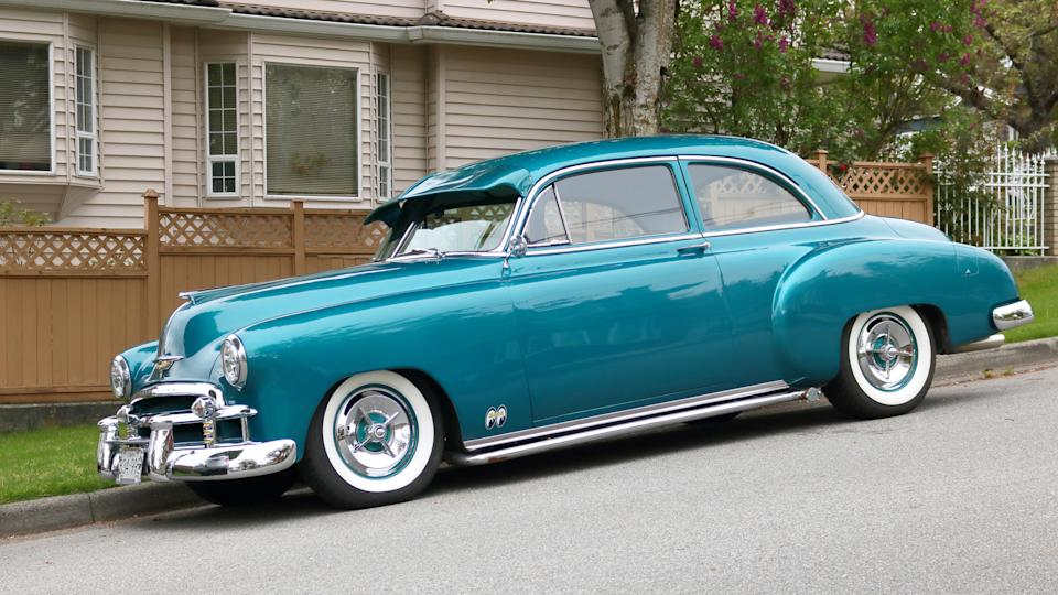 VANCOUVER, BC/Canada - May 7, 2018: The side, profile view of a fully restored 1951 Chevrolet Bel Air parked in a residential street in Vancouver, British Columbia, Canada on May 7, 2018.