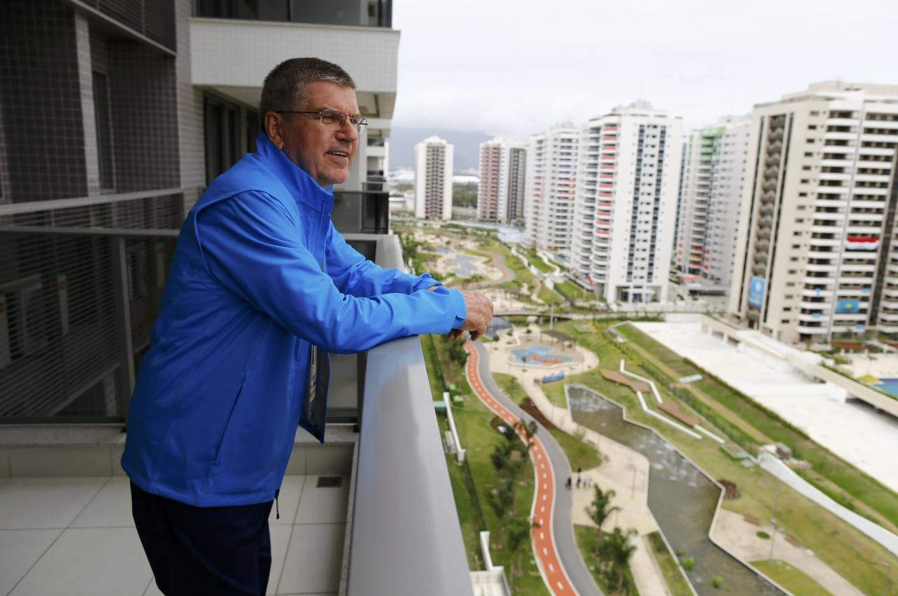 International Olympic Committee (IOC) President Thomas Bach looks from his balcony after moving into the Olympic village in Rio de Janeiro, Brazil, July 28, 2016.    REUTERS/Ivan Alvarado TPX IMAGES OF THE DAY. FOR EDITORIAL USE ONLY. NOT FOR SALE FOR MARKETING OR ADVERTISING CAMPAIGNS.