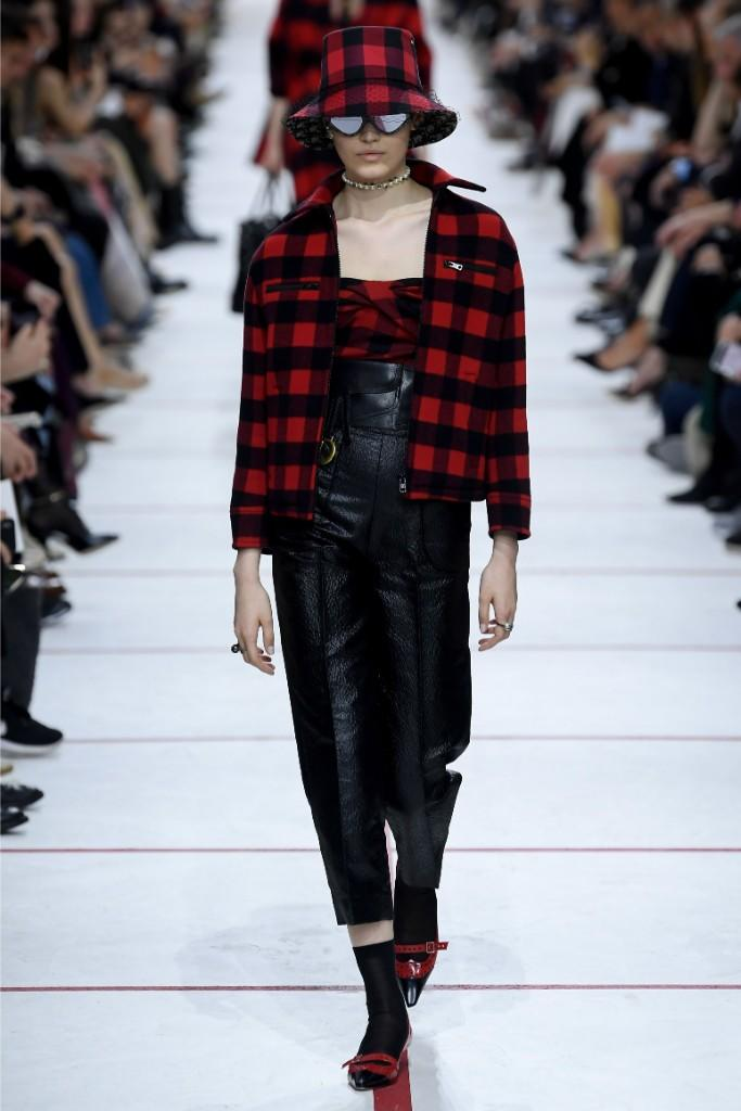 A model in red plaid and leather at Dior.