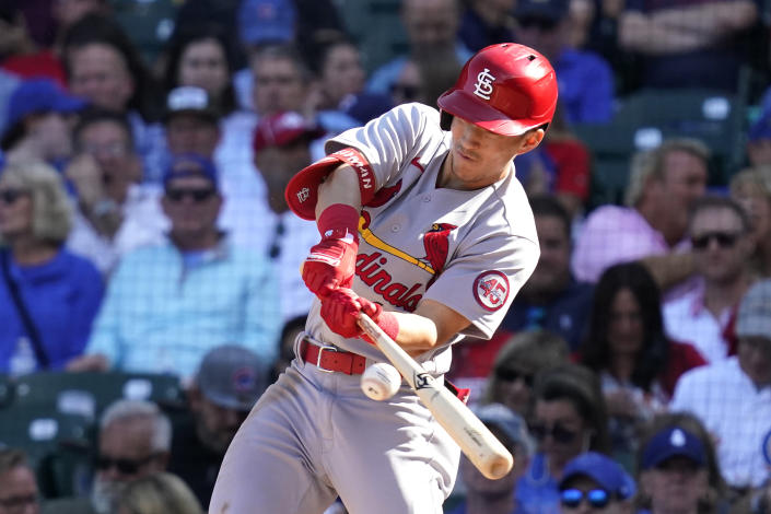 St. Louis Cardinals' Tommy Edman hits a one-run single during the sixth inning in the first baseball game of a doubleheader against the Chicago Cubs in Chicago, Friday, Sept. 24, 2021. (AP Photo/Nam Y. Huh)