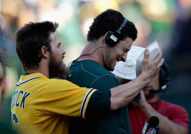 Josh Reddick gives Freiman the walk-of treatment after driving in the winning run against Mariano Rivera in the 18th inning of a 2013 game. (Getty Images)
