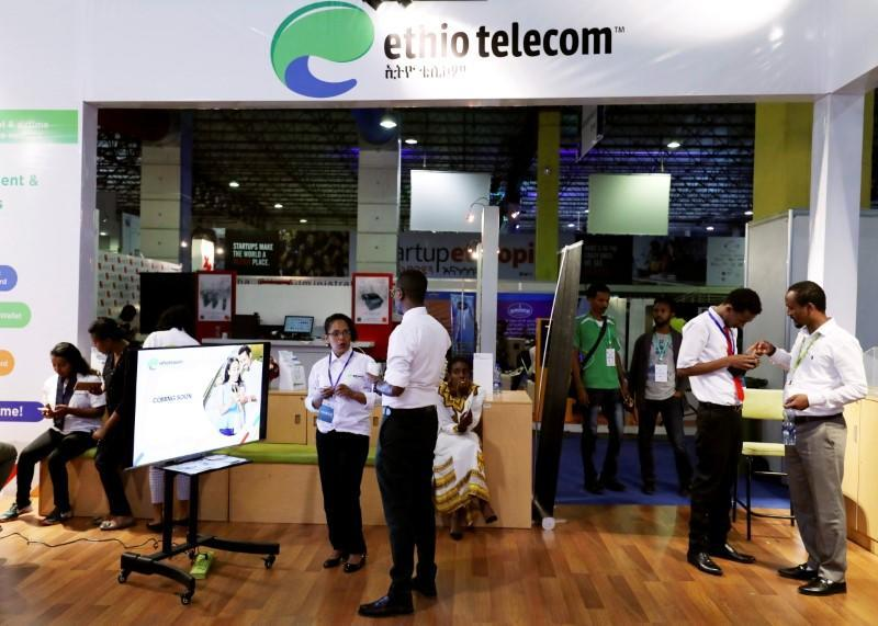 FILE PHOTO: Customers receive assistance from staff members at an Ethio Telecom branch in Addis Ababa