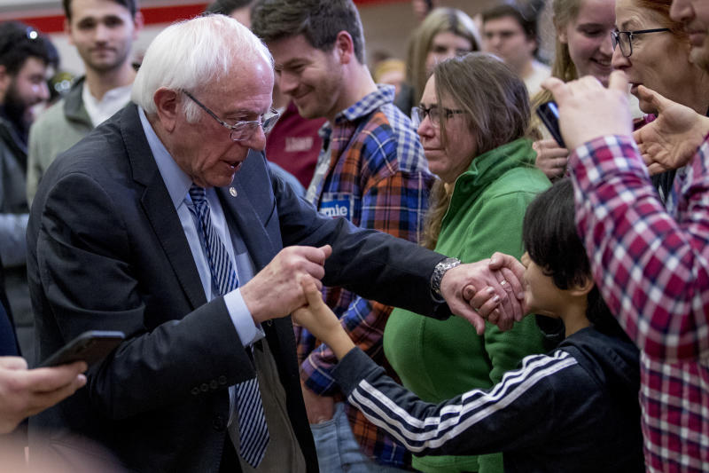 Democratic presidential candidate Sen. Bernie Sanders, I-Vt., greets members of the audience after speaking at a campaign stop at Stevens High School, Sunday, Feb. 9, 2020, in Claremont, N.H. (AP Photo/Andrew Harnik)