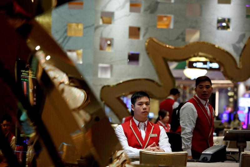 FILE PHOTO: Employees inside the casino prepare for the opening of MGM Cotai in Macau