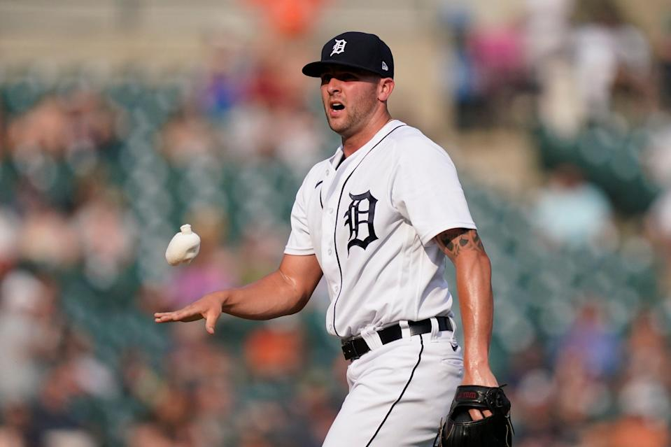 Detroit Tigers relief pitcher Alex Lange tosses the rosin bag during the fifth inning of a baseball game against the Chicago White Sox, Saturday, June 12, 2021, in Detroit.