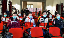 Doctors and members of the Chinese Red Cross pose for a photo prior to a press conference in Rome, Friday, March 13, 2020. A charter plane carrying members of a medical team and several tons of medical supplies from China arrived in Rome late Thursday to assist Italy in fighting the coronavirus outbreak. For most people, the new coronavirus causes only mild or moderate symptoms. For some it can cause more severe illness. (Alfredo Falcone/LaPresse via AP)