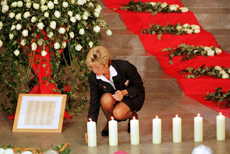 FILE - In this Sept. 11, 1998, file photo, a Swissair member lights a candle during a memorial service in Zurich for the victims of Swissair Flight 111, which crashed into the Atlantic Ocean off Peggy's Cove, Nova Scotia, on Sept. 2 killing 229 people. The plane crash was among Canada's deadliest accidents in the last 150 years, killing 229. Police say 50 people are presumed dead following a July 6, 2013, fiery oil train crash in Lac-Megantic, Quebec, making it Canada's worst railway crash in nearly 150 years. (AP Photo/Christoph Ruckstuhl, File)