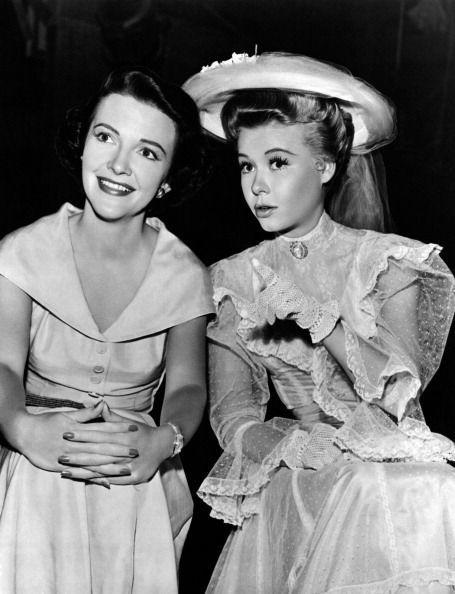 <p>While on the set of <em>The Belle of New York</em>, dancer and actress Vera-Ellen chats with future First Lady Nancy Reagan, while watching Fred Astaire dance during a take. </p>
