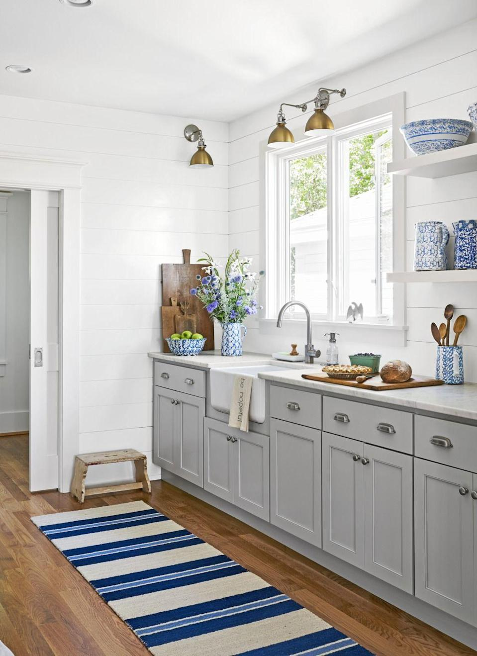 "<p>The year 2020 is not about being matchy-matchy—and that goes double for your heavy metals. Choose a nice nickel for your knobs and then go with a cool brass or matte white for your faucet. Choose a whole different metal for your lighting fixtures. <br></p><p><a class=""link rapid-noclick-resp"" href=""https://www.amazon.com/s?k=kitchen+rugs&ref=nb_sb_noss&tag=syn-yahoo-20&ascsubtag=%5Bartid%7C10050.g.3988%5Bsrc%7Cyahoo-us"" rel=""nofollow noopener"" target=""_blank"" data-ylk=""slk:SHOP KITCHEN RUGS"">SHOP KITCHEN RUGS</a></p>"