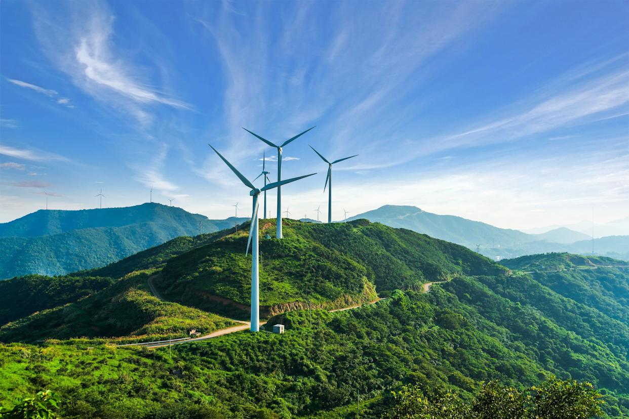 Wind turbines in Zhejiang province, China. In many places wind and solar power are already cheaper than fossil fuels. (Photo: jia yu via Getty Images)