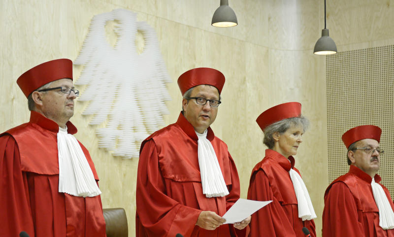 Andreas Vosskuhle, second left, presiding judge of the German constitutional court is flanked by other judges, from left, Peter Huber, Gertrude Luebbe-Wolff and Herbert Landau as he announces their verdict on the permanent eurozone rescue fund in Karlsruhe, southern Germany, Wednesday, Sept. 12, 2012. Germany's highe court on Wednesday rejected calls to block the Europe's permanent rescue fund, paving the way in a much-anticipated ruling for its ratification by the country's president. (AP Photo/dapd, Ronald Wittek)